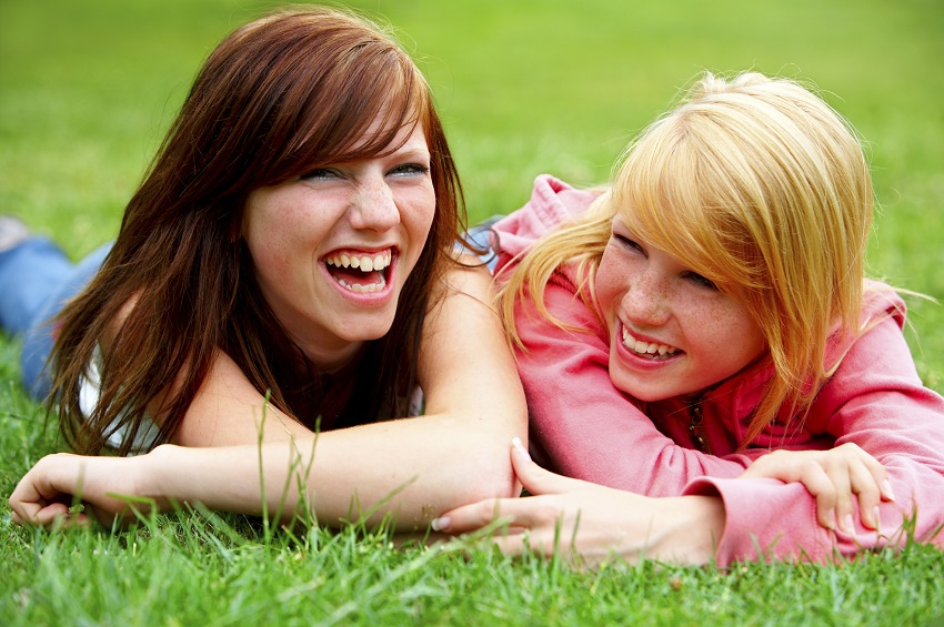 Two young teens relaxing in a park.The concept of this series of pictures is youth, summer, and teenage lifestyle.